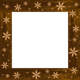 Wooden photo frame with carved flowers Royalty Free Stock Photography