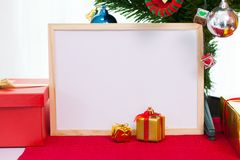 Wooden photo frame with christmas decoration on red carpet. Red. Boxes gift New year greeting card template Stock Photography