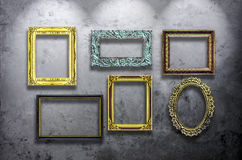 Wooden photo frame on concrete wall Royalty Free Stock Photo