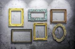 Wooden photo frame on concrete wall Stock Photos
