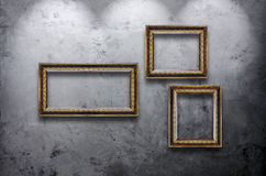 Wooden photo frame on concrete wall Royalty Free Stock Photography