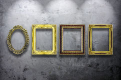 Wooden photo frame on concrete wall Royalty Free Stock Image