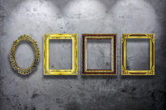 Wooden photo frame on concrete wall Royalty Free Stock Photos