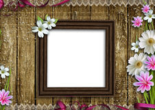 Wooden photo frame with flowers Royalty Free Stock Photo