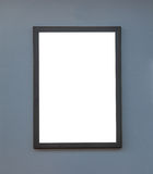 Wooden photo frame on grey wall background Stock Image