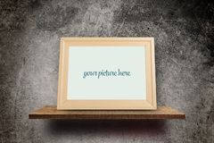 Wooden photo frame on Grungy concrete Stock Photography