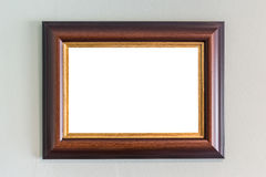 Wooden photo frame hanging on the wall. Interior decoration Royalty Free Stock Photography