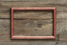 Photo frame on wooden wall Royalty Free Stock Photos