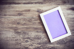 Wooden photo frame on old wooden wall Stock Photos