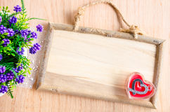 Wooden photo frame and pendant in the shape of heart Stock Images