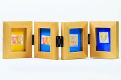 Wooden photo frame for 4 pictures Zdjęcia Stock