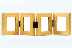 Wooden photo frame for 4 pictures obraz stock