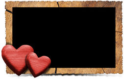 Wooden Photo Frame with Red Hearts. Rectangular empty wooden frame with two red wooden hearts isolated on white royalty free illustration