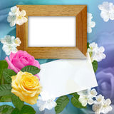 Wooden photo frame with roses Stock Images