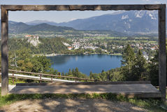Wooden photo frame with the view across Lake Bled, Slovenia. Royalty Free Stock Photos