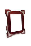 Wooden photo frame. On a white background Royalty Free Stock Photo