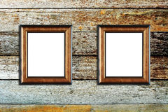 Wooden photo frame on wood background Royalty Free Stock Image