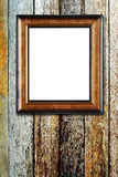 Wooden photo frame on wood background Stock Images
