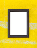 Wooden photo frame on yellow wall Royalty Free Stock Image