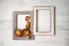 Wooden photo frames with dry roses Stock Photo