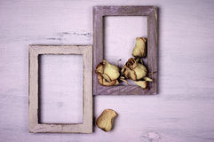 Wooden photo frames with dry roses Royalty Free Stock Photography