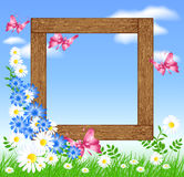 Wooden photo frames with flowers and butterfly Royalty Free Stock Photos