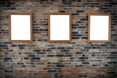 Wooden photo frames on wall. Wooden photo frames on brick wall Royalty Free Stock Photography
