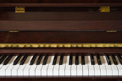 Wooden piano front view, closeup Royalty Free Stock Photography