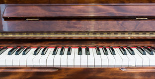 Wooden piano and white keys Royalty Free Stock Photo