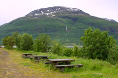 Wooden picnic table against Norwegian landscape Stock Image