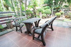 Wooden picnic table with benches Stock Images