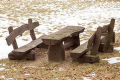 Wooden picnic table with benches Stock Photos