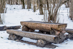 Wooden picnic table with benches. In the winter park recreation area Stock Photography
