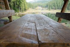 Wooden picnic table by the lake. In autumn in northern Romania Stock Photography