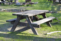 Wooden picnic table. Stock Images