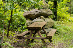 Wooden picnic table in public park Stock Photos