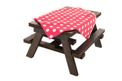 Wooden picnic table. And seats isolated over white background Stock Photos