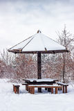 Wooden picnic table with wooden umbrella at winter Stock Image