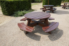 Wooden picnic tables in park Royalty Free Stock Photo