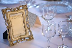 Wooden picture frame with copy space positioned on a table prepared for a special event stock photography