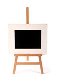 Wooden picture frame on a easel isolated on white stock photos