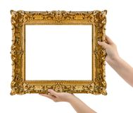 Wooden picture frame in hands Stock Photo