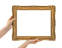 Wooden picture frame in hands Stock Photography