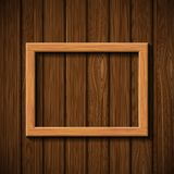 Wooden picture frame hanging on the wall Royalty Free Stock Image