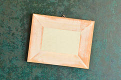 Wooden picture frame on old wall Royalty Free Stock Photo