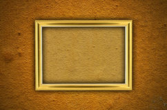 Wooden picture frame on orange wall Stock Images