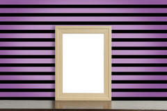 Wooden Picture frame on pink and black punk style stripe wall Stock Photos