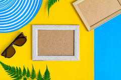 Wooden picture frame and set object vacation relax on colorful p. Aper with travel and fashion style Royalty Free Stock Photos