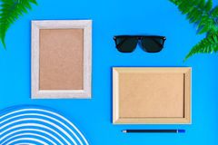 Wooden picture frame and set object vacation relax on colorful p. Aper with travel and fashion style Royalty Free Stock Photo