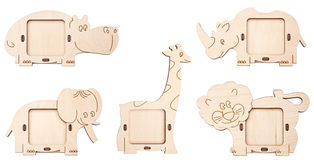 Wooden picture frames in the form of animals. Isolated wooden picture frames in the form of animals stock photo